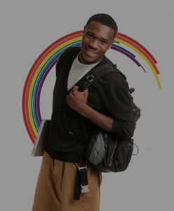 Guy smiling with backpack and a laptop