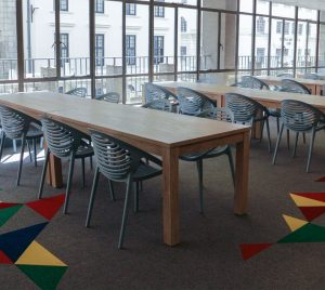 Long tables with chairs on either side