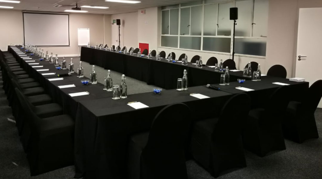 Meeting room with 3 long tables with chairs