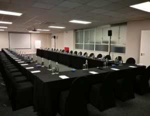 Boardroom with 3 long tables and chairs