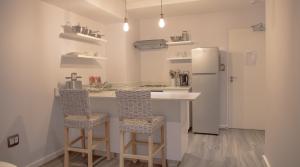 Open plan kitchen with 2 kitchen chairs