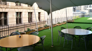 Outside terrace with 2 round tables and chairs