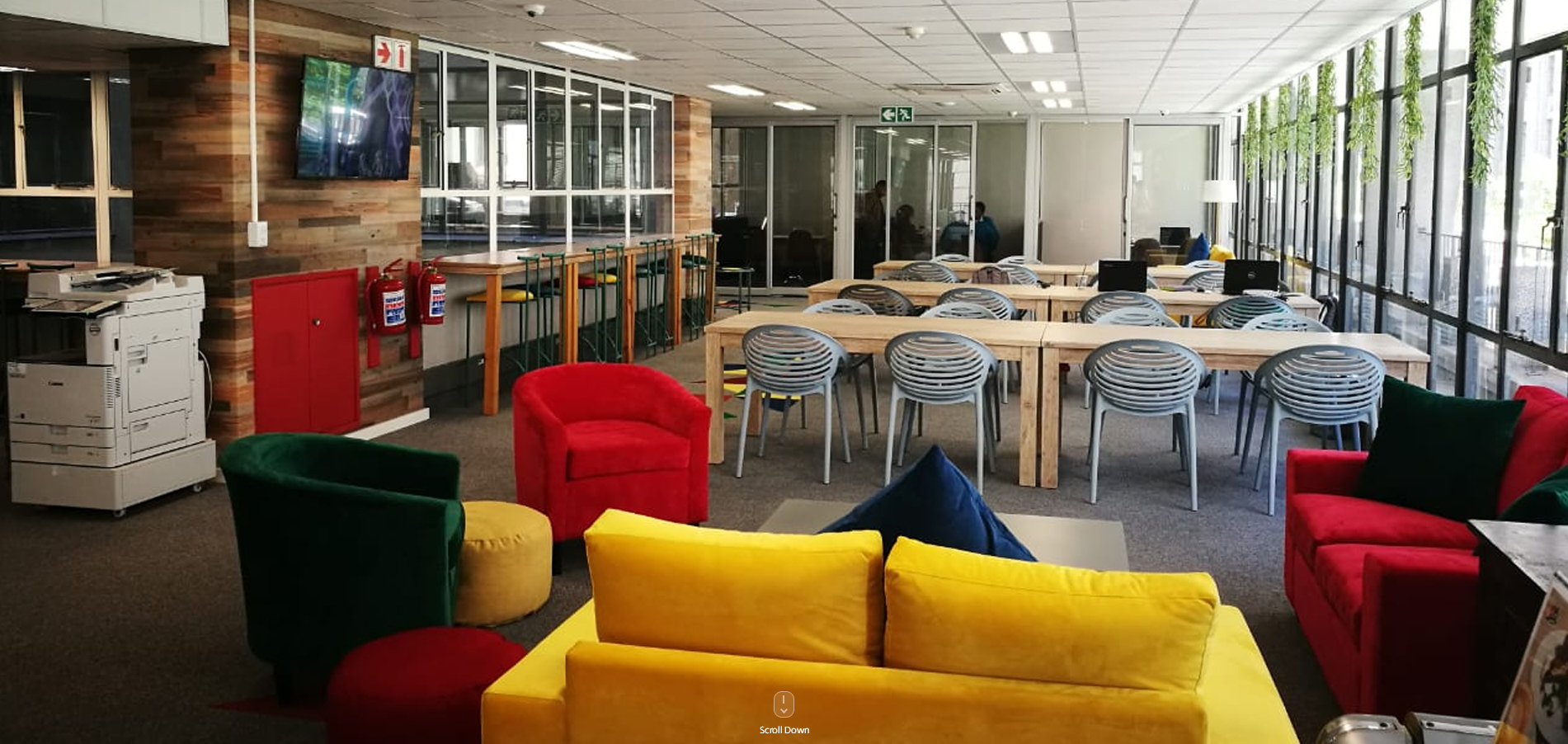 Open office work space with chairs, tables and couches